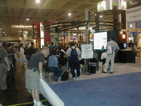trade Show Booth - Crowd Watching Presentation While Carpets Being Rolled-up